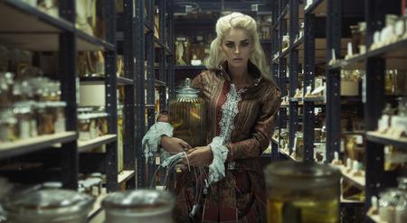 Blond attractive lady in the retro laboratory photo