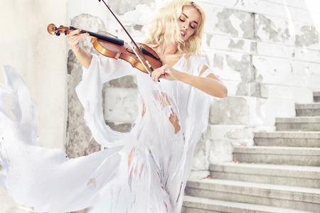 Amazing portrait of the pretty female musician photo