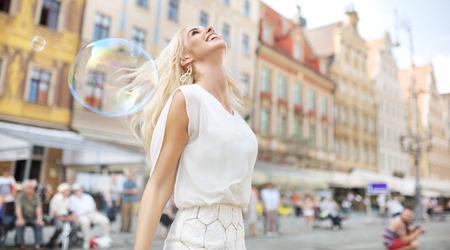 Joyful woman among the soap bubbles photo