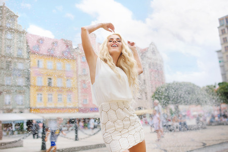 Fine portrait of the blond woman during the summer photo