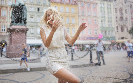 Funny photo of the wet blond woman photo