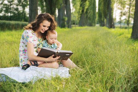 Brunette  mother reading tales for her little child