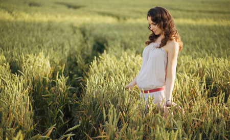 Portrait of the woman on the fresh cereal field photo