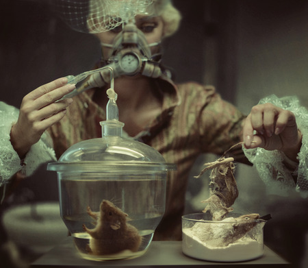 Retro chemist making a creepy experiment photo
