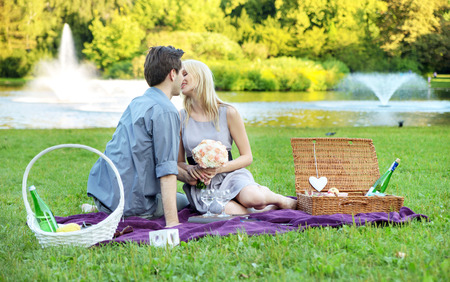 Young couple on the very romantic date in the park photo