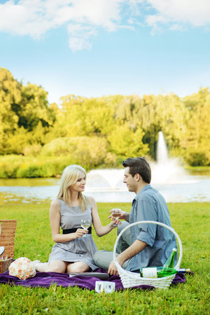 Couple having romantic date in the summer park photo