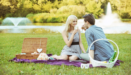 Young couple on the summer picnic photo