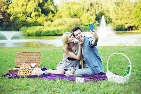 Young cheerful couple making the self portrait photo