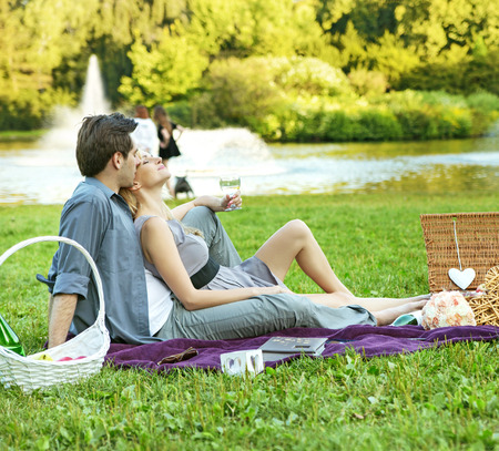 Cheerful couple resting in the park photo