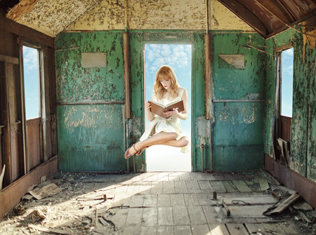 hovel: Levitating redhead reading in the hovel