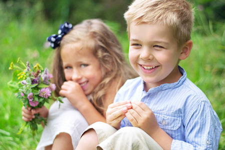 Portrait of cute children with colorful flowers photo