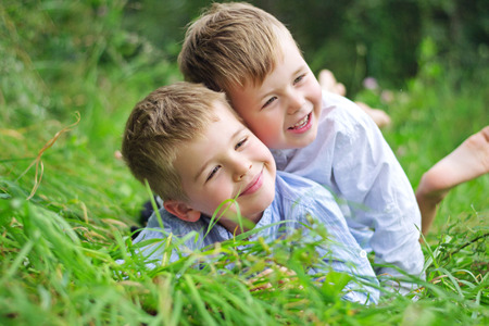 family garden: Portrait of two joyful brothers