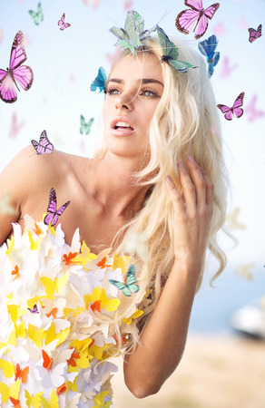 fantasy woman: Alluring blonde wearing the butterfly dress Stock Photo