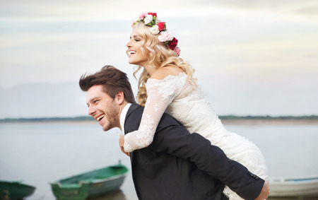 Happy husband carrying his lovely wife