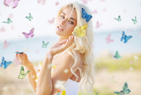 metamorphose: Beautiful woman among hundreds colorful butterflies