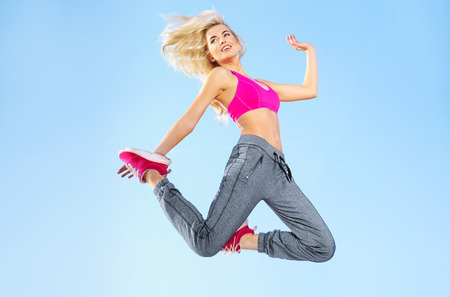 Fit blond lady doing exercises photo