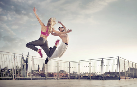 Athletic couple during the hard jump training Stock Photo