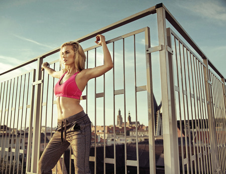 sexy nude blonde: Sexy athlete doing exercises on the roof