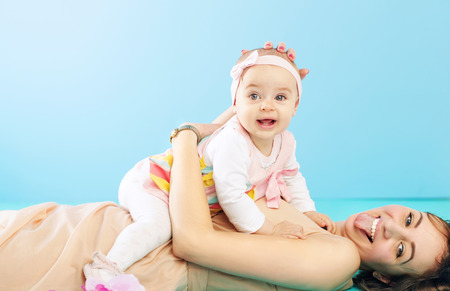 funny faces: Mother and daughter making funny faces Stock Photo