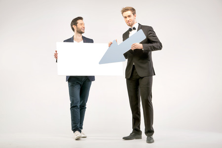 Handsome and cheerful men advertising sales photo