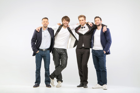 team mate: Group of four cheerful guy friends Stock Photo