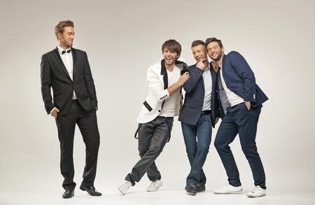 Laughing men in elegant clothes