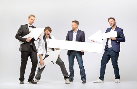 display advertising: Group of cheerful men with arrows and boards