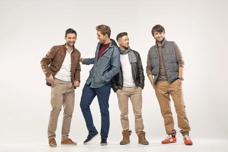 divat: Csoport az elégedett, vidám barátok Stock fotó