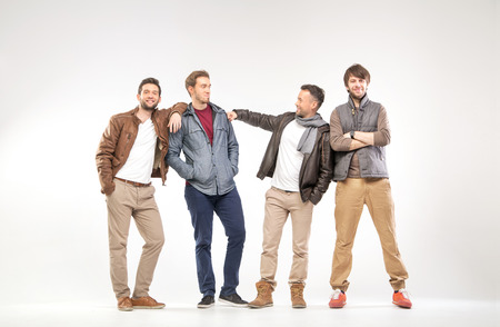 students group: Group of smart guys advertising clothes