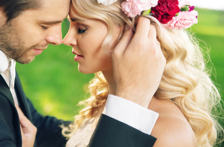 romantic kiss: Closeup portrait of the young marriage couple