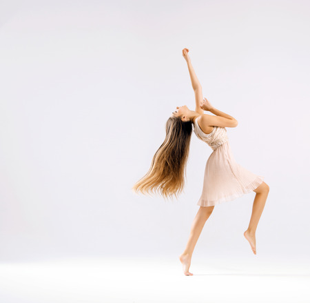 girl action: Slim and talented ballet dancer