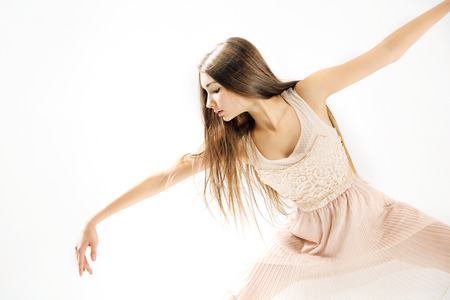 dance studio: Young, pretty and talented ballet dancer Stock Photo