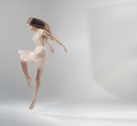 woman flying: Talented pretty jumping ballet dancer Stock Photo