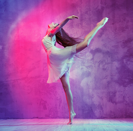 Flexible pretty ballet dancer on the dance floor
