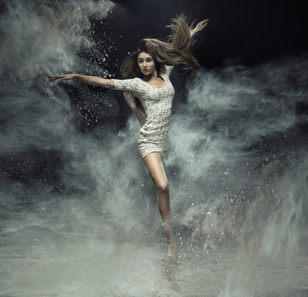 Talented ballet dancer catching the white dust Stock Photo