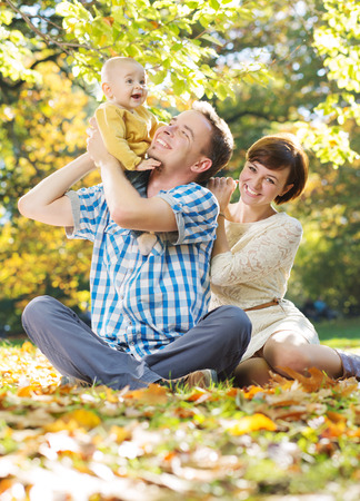spare time: Young parents enjoying spare time with chiild Stock Photo