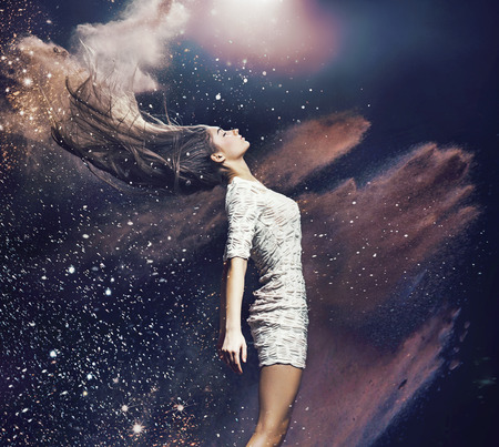 Art picture of the ballet dancer among colorful dust Stock Photo