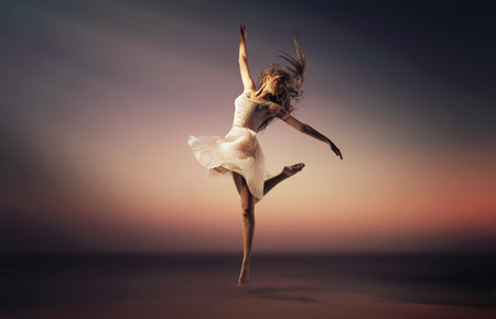 Romantic mood portrait of the jumping ballet dancer