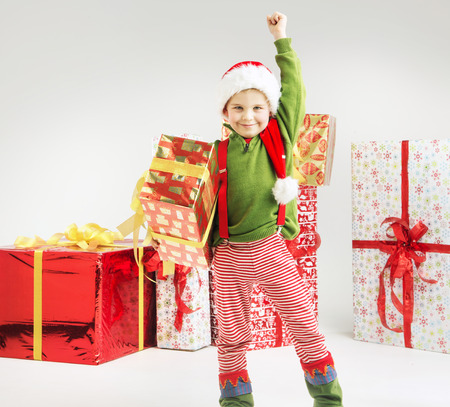 Cute little elf with big gift photo