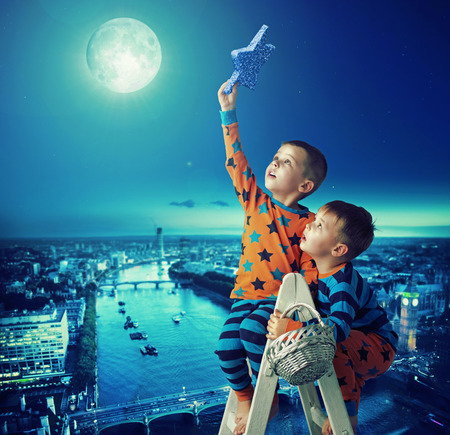 dream house: Two brothers holding the magic star Stock Photo