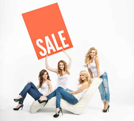 promoting: Attractive ladies promoting middle-season sale