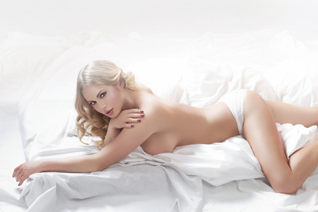 nude lady: Portrait of half-nude sensual lady in bed