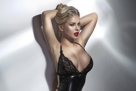 Sensual blond woman showing her body