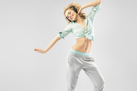 sexy headphones: Blond alluring lady dancing alone Stock Photo