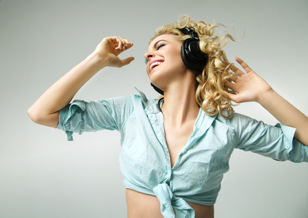 Laughing woman enjoying the realaxing music