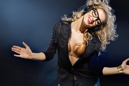 sexy headphones: Portrait of a blonde woman with headphones Stock Photo