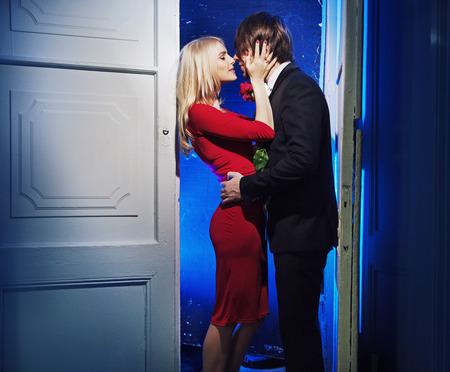 handome: Handome boyfriend kissing his lovely girlfriend Stock Photo