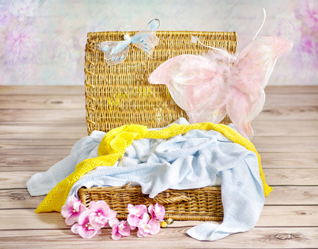 Colorful towels in the wicker basket photo
