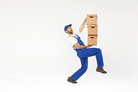 Funny picture of man holding paper boxes photo