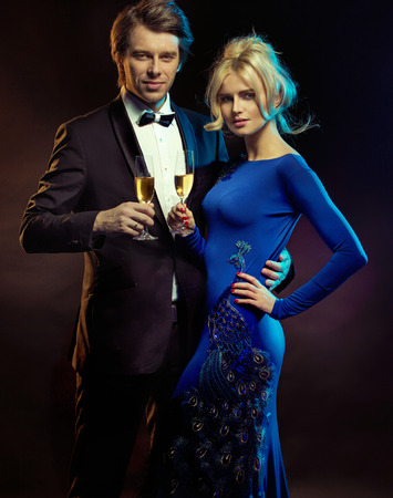 elegant couple: Portrait of an elegant couple with glasses of champagne Stock Photo